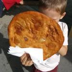 Kid eating a langos