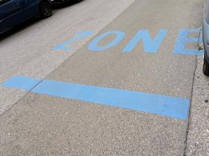 Blue parking zone road markings