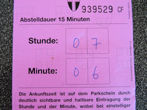 Filled-out 15 minute parking voucher