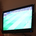 TV screen showing football