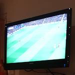 TV screen showing football