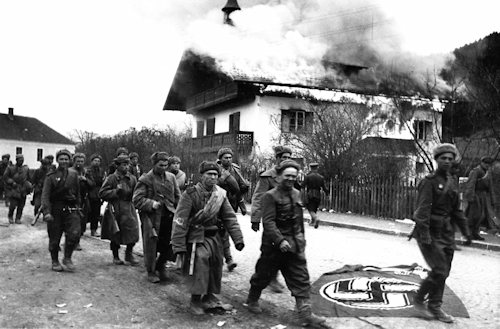 Soldiers and a burning house